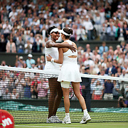 LONDON, ENGLAND - JULY 15:  Garbine Muguruza of Spain is congratulated by Venus Williams of The United States after her victory in the Ladies Singles final during the Wimbledon Lawn Tennis Championships at the All England Lawn Tennis and Croquet Club at Wimbledon on July 15, 2017 in London, England. (Photo by Tim Clayton/Corbis via Getty Images)