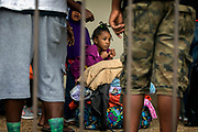 An unidentified little girl waits with her family at the Savannah Civic Center to evacuate from he path of Hurricane Irma, Saturday, Sept., 9, 2017 in Savannah, Ga. (AP Photo/Stephen B. Morton)
