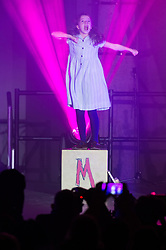 © Licensed to London News Pictures. 13/11/2018. London, UK. SARA MUNDAY from Matilda The Musical performs before turning on the lights of Covent Garden Market Christmas lights. Photo credit: Ray Tang/LNP