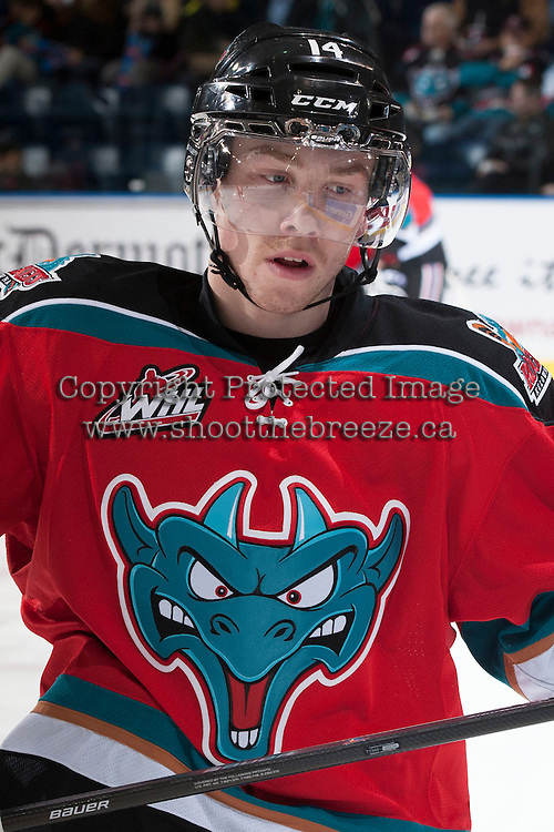 KELOWNA, CANADA - NOVEMBER 30: Rourke Chartier #14 of the Kelowna Rockets warms up against the Kamloops Blazers on November 30, 2013 at Prospera Place in Kelowna, British Columbia, Canada.   (Photo by Marissa Baecker/Shoot the Breeze)  ***  Local Caption  ***