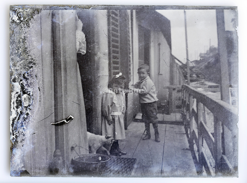 family snap image on eroding glass plate