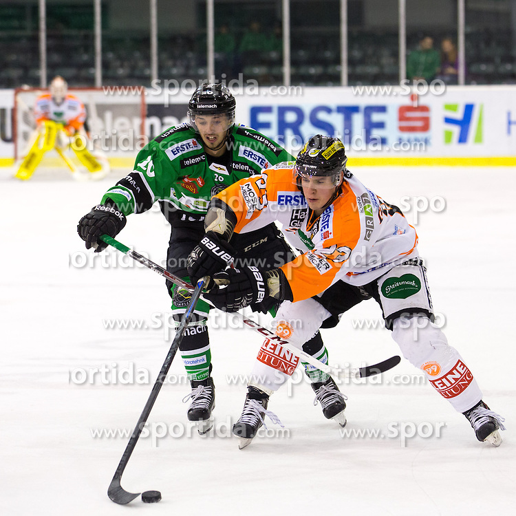 31.10.2014, Hala Tivoli, Ljubljana, SLO, EBEL, HDD Telemach Olimpija Ljubljana vs Moser Medical Graz 99ers, 15. Runde, in picture Gregor Koblar (HDD Telemach Olimpija, #20) vs Mitch Ganzak (Moser Medical Graz 99ers, #23) during the Erste Bank Icehockey League 15. Round between HDD Telemach Olimpija Ljubljana and  Moser Medical Graz 99ers at the Hala Tivoli, Ljubljana, Slovenia on 2014/10/31. Photo by Matic Klansek Velej / Sportida