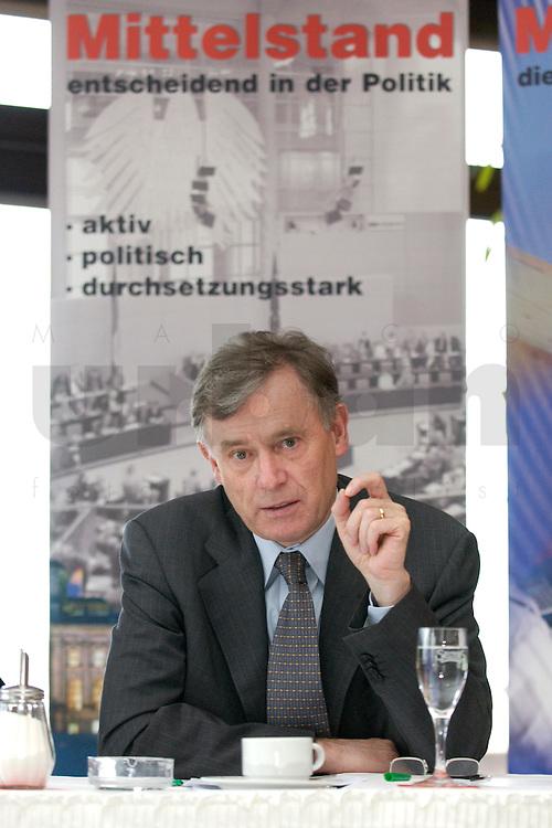 10 MAY 2004, BERLIN/GERMANY:<br /> Horst Koehler, Kandidat fuer das Amt des Bundespraesidenten, waehrend einem Gespraech von Koehler mit dem Bundesvorstand der Mittelstands- und Wirtschaftsvereinigung der CDU/CSU, MIT, Conference Center, Flughafen Tegel<br /> Horst Koehler, candidate for the post of the Federal President of Germany<br /> IMAGE: 20040510-01-045<br /> KEYWORDS: Horst K&ouml;hler, Praesidentschaftskandidat,. Pr&auml;sidentschaftskandidat, Bundespr&auml;sident