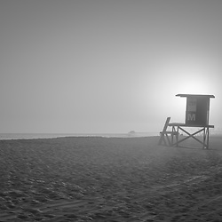 Lifeguard tower M Newport Beach CA sunset black and white photo. Newport Beach is a popular coastal beach city in Orange County Southern California in the Western United States of America. Copyright ⓒ 2017 Paul Velgos with all rights reserved.