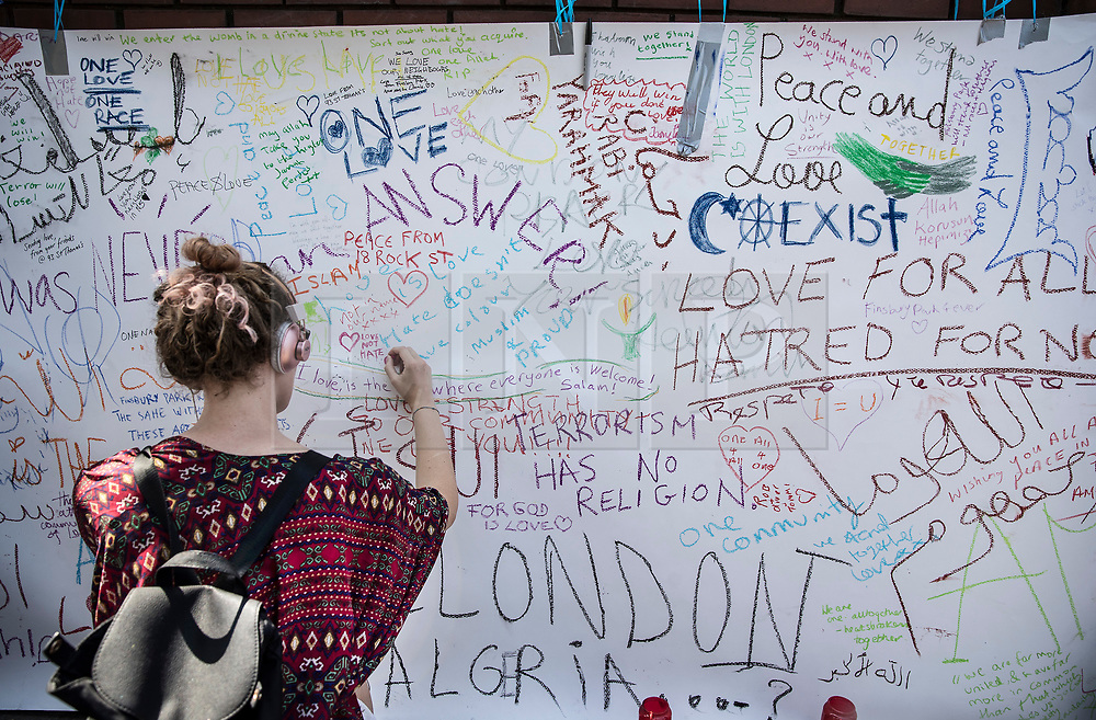 © Licensed to London News Pictures. 20/06/2017. London, UK. Messages are written on a banner placed outside Finsbury Park Mosque after worshippers were targeted in an attack yesterday. One person has been killed and 10 people are injured. Darren Osborne, 47, from Cardiff, continues to be held on suspicion of attempted murder and alleged terror offences.  Photo credit: Peter Macdiarmid/LNP