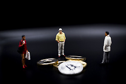 October 3, 2017 - L'Aquila, Italy - Miniature figures near Bitcoin and Litecoin Coin. (Credit Image: © Manuel Romano/NurPhoto via ZUMA Press)