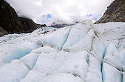 Glacial ice embedded with moraine sediment transported by Fox glacier, New Zealand