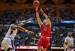 Jan 2, 2019; Morgantown, WV, USA; Texas Tech Red Raiders guard Matt Mooney (13) shoots a jumper during the first half against the West Virginia Mountaineers at WVU Coliseum. Mandatory Credit: Ben Queen-USA TODAY Sports