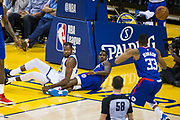Golden State Warriors forward Kevin Durant (35) watches the ball while laying on the court after blocking a LA Clippers shot at Oracle Arena in Oakland, Calif., on January 10, 2018. (Stan Olszewski/Special to S.F. Examiner)