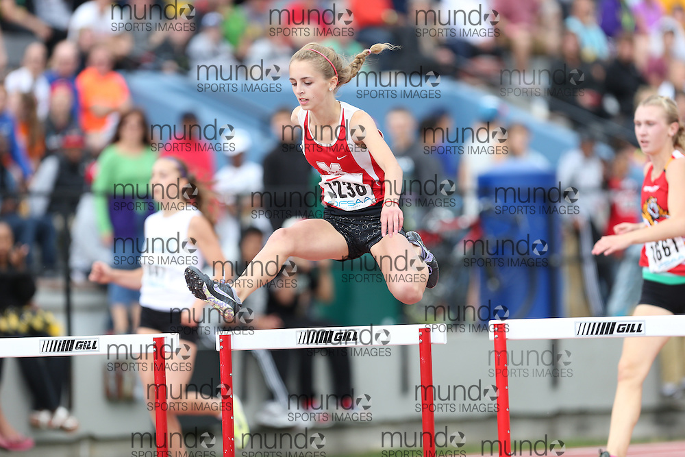 Kylie Paliani of Medway HS - Arva runs to victory in the 300 hurdles final at the 2013 OFSAA Track and Field Championship in Oshawa Ontario, Thursday,  June 6, 2013.<br /> Mundo Sport Images / Sean Burges