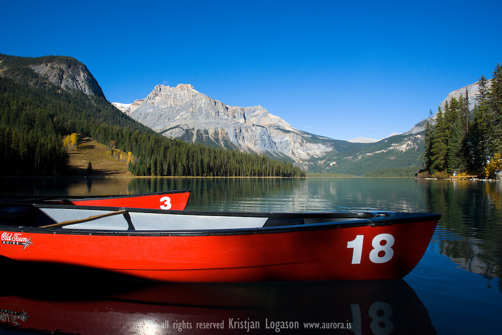 Red canoe on Emerald lake on a calm october morning
