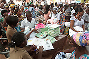 Ghana: 25 April 2012, Health workers register children before their get weighed and vaccinated at the Dodowa new town health outreach point in Dodowa.The GAVI Alliance is a public-private partnership that brings together developing country and donor governments, WHO, UNICEF, the World Bank, the vaccine industry in both industrialised and developing countries, research and technical agencies, civil society, the Bill & Melinda Gates Foundation and other private philanthropists.  Set up in 2000 as the Global Alliance for Vaccines and Immunisation, GAVI's mission is to save children's lives and protect people's health by increasing access to immunisation in the world's poorest countries.