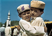 BANGALORE,2001.<br /> Friends Mohammed Aziz(left) and Ismail Mohammed (right) greet each other during the Eid celebrations in Shivajinagar.