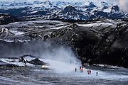 Helecopter dropps off passangers to view the erupting volcano on Fimmvörðuháls/Eyjafjallajökull, April 2010. South Iceland