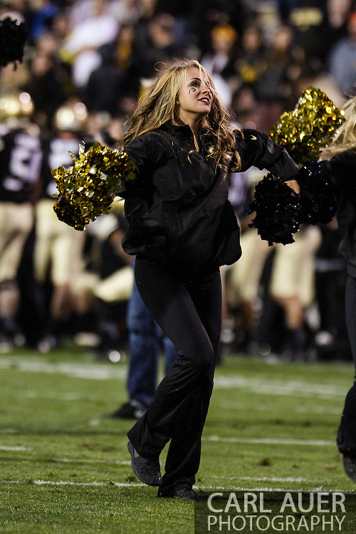 October 5th, 2013:  A Colorado cheerleader in action during the NCAA football game between the University of Oregon Ducks and the Colorado Buffaloes at Folsom Field in Boulder, Colorado