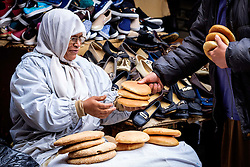 A woman selling bread in the medina in Marrakech, Morocco, North Africa<br /> <br /> (c) Andrew Wilson | Edinburgh Elite media