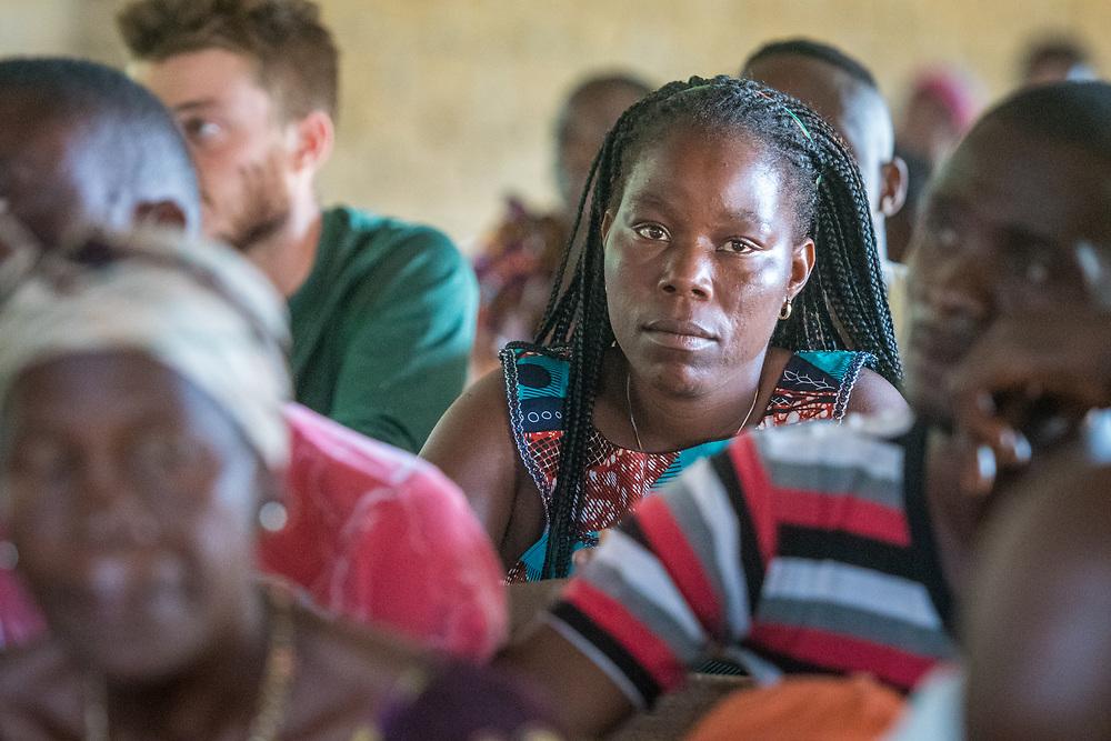 A woman sits among a class in Ganta, Liberia