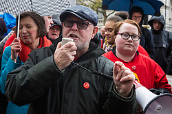 London, UK. 12 November, 2019. Ronnie Draper, General Secretary of the Bakers' Food and Allied Workers' Union (BFAWU), addresses McDonald's workers belonging to the Bakers Food & Allied Workers Union (BFAWU) assembled opposite Downing Street during strike action, dubbed a 'McStrike', to call for a New Deal for McDonald's Workers which would include £15 an hour, an end to youth rates, the choice of guaranteed hours of up to 40 hours a week, notice of shifts four weeks in advance and union recognition.