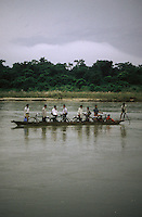 Locals transport their bicycles across Royal Chitwan National Park's Rapti River by canoe.