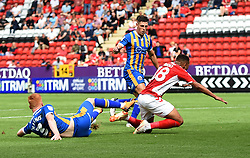 Charlton Athletic's Karlan Ahearne-Grant stacked by Shrewsbury Town's Ryan Hanes