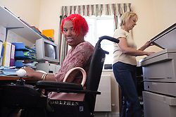 Young woman with disability working in office,