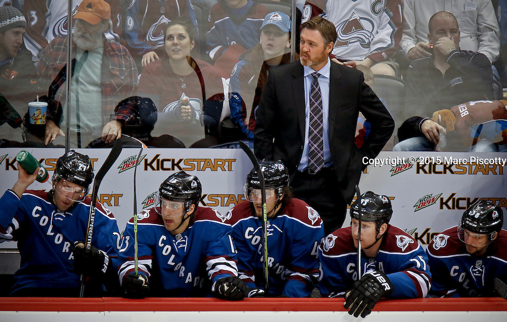 SHOT 3/28/15 8:13:13 PM - Colorado Avalanche head coach Patrick Roy watches his team play against the Buffalo Sabres during their regular season NHL game at the Pepsi Center in Denver, Co. The Avalanche won the game 5-3. (Photo by Marc Piscotty / © 2015)
