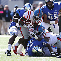 Lauren Wood | Buy at photos.djournal.com<br /> Ole Miss running back Jaylen Walton is tackled by Memphis linebacker Genard Avery during Saturday's game at Memphis.