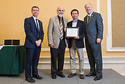 Presidential Teacher Award finalist Chao-Yang Lee accepts his award at Baker Ballroom on Oct. 31, 2018. Photo by Hannah Ruhoff