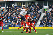 Queens Park Rangers striker Sebastian Polter (33) challenges Preston North End Defender Bailey Wright during the Sky Bet Championship match between Preston North End and Queens Park Rangers at Deepdale, Preston, England on 19 March 2016. Photo by Pete Burns.