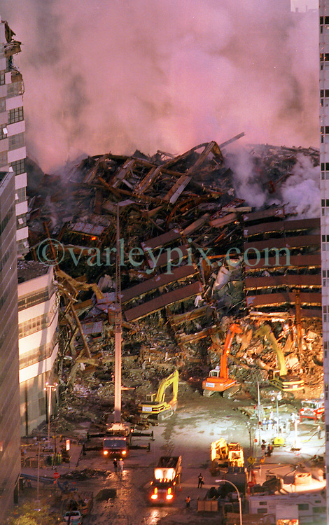 16 Sept 2001. Twin Towers World Trade Center, New York City, NY. 9-11.<br /> The still smoldering remains of the World Trade Center Twin Towers following a heinous terrorist attack by Al Qaeda operatives. <br /> Photo credit©; Charlie Varley/varleypix.com.