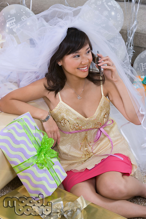Bride using mobile phone at bridal shower