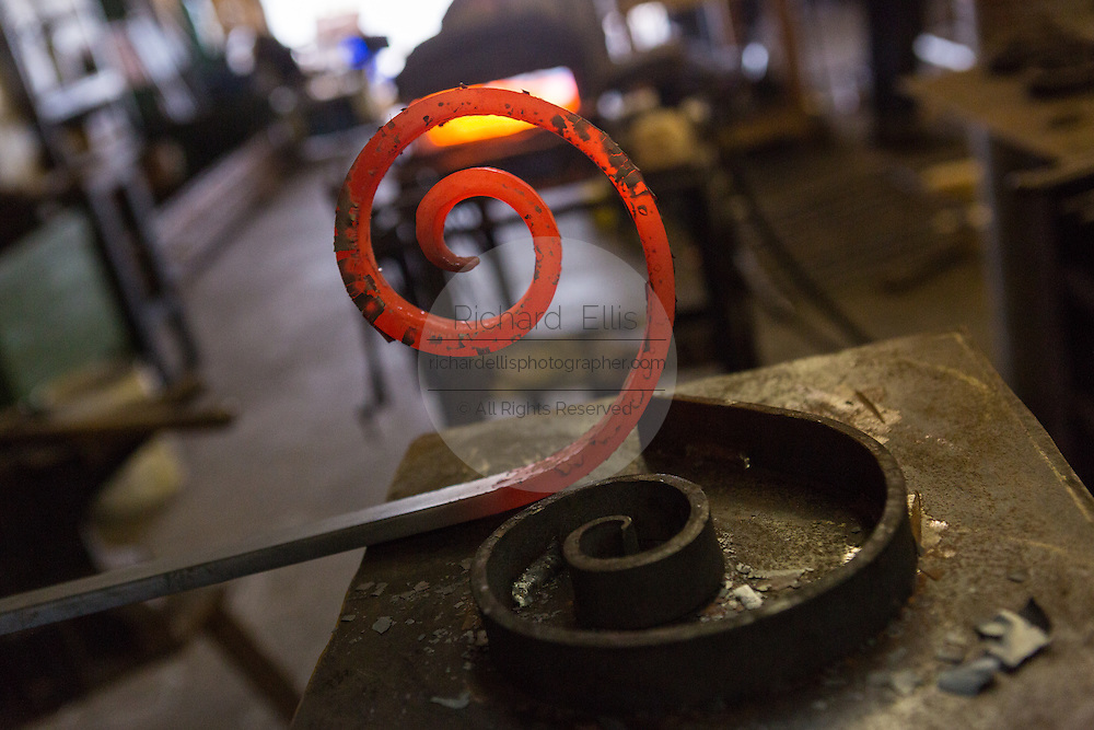 Freshly shaped red hot steel in an metal shop in Charleston, SC