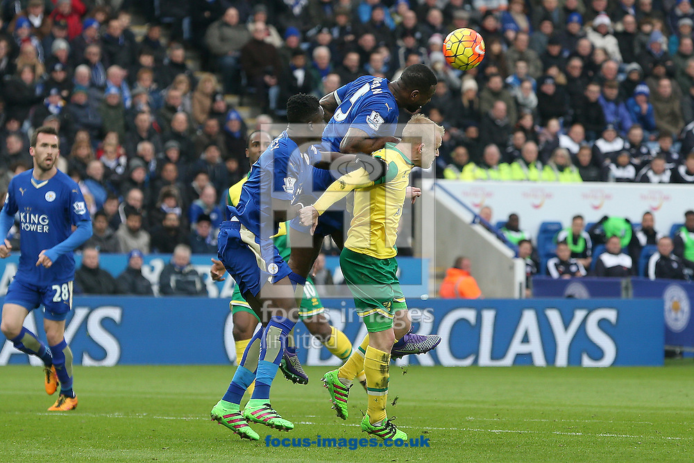 Steven Naismith of Norwich and Wes Morgan of Leicester City compete for a header during the Barclays Premier League match at the King Power Stadium, Leicester<br /> Picture by Paul Chesterton/Focus Images Ltd +44 7904 640267<br /> 27/02/2016