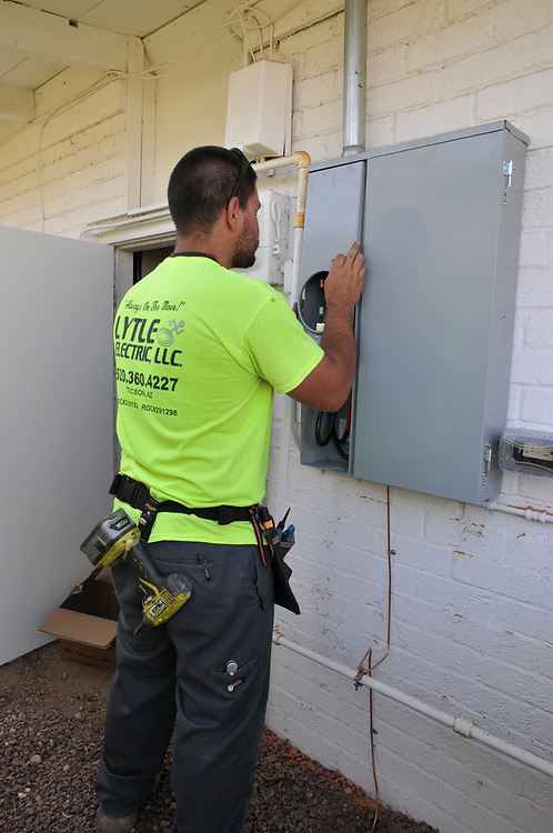 Lytle Electric worker installs new panel.