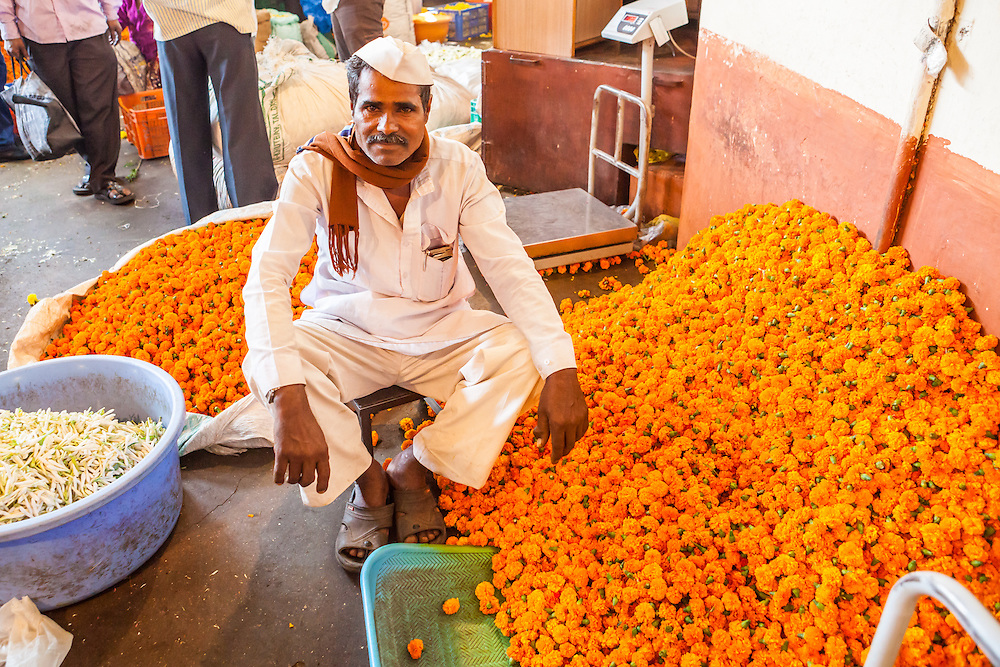 A man in a flower market, Pune, India.