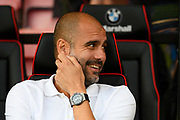 Manchester City manager Pep Guardiola smiles before the Premier League match between Bournemouth and Manchester City at the Vitality Stadium, Bournemouth, England on 26 August 2017. Photo by Graham Hunt.