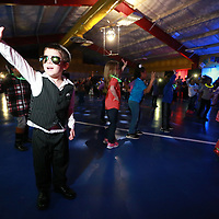 """Jace Linderman, 5, does his best """"Saturday Night Fever"""" dance as he and his parents enjoy the disco at Joyner Elementary School Thursday night."""