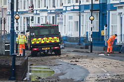 © London News Pictures. 04/01/2018. Aberystwyth, UK.   Repair works begin to fix damage caused to seafront at Aberystwyth by storm Eleanor. Strong westerly winds gusting over 75 mph whipped the high Spring Tide into huge waves yesterday, that batter the seafront at Aberystwyth on the Cardigan Bay coast of west Wales. Photo credit: Keith Morris/LNP