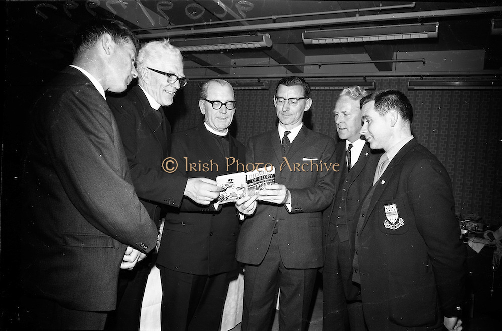 "17/05/1966<br /> 05/17/1966<br /> 17 May 1966<br /> Book reception for ""Decades of Glory: A Comprehensive History of the National Game"" by Raymond Smith.<br /> This reception was held in the offices of W.D. & H.O. Wills to honour the well known author and journalist, Raymond Smith. His book on the history of Hurling (""Decades of Glory"") has just been published with the assistance of Wills of Dublin and Cork and the Central Council of the G.A.A.<br /> Picture shows tipperary players and officials of the G.A.A., who attended the reception. From left to right: Jimmy Smith (Executive Officer of the G.A.A.), Rev. Fr. Hilery Barry (C.P. Mount Argus, Dublin), Rev. Brother J. Hutton (Superior, C.B.S. Thurles), Raymond Smith (author), Jim Ryan (Chairman of the Munster Board), and Jimmy Doyle (Tipperary hurler)."
