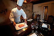 Yudai Hanno, head chef at Ukai-tei teppanyaki restaurant, prepares steak on a griddle at the restaurant in Omotesando district of Tokyo.