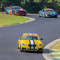 Alton, VA - Aug 26, 2016:  The JDC-Miller Motorsports BMW 228i races through the turns at the Oak Tree Grand Prix at Virginia International Raceway in Alton, VA.