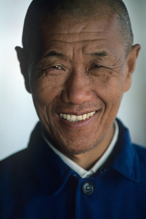 China, Sichuan Province, Fengjie, Portrait of Asian man aboard Yangtze River ferry near city of Fengjie
