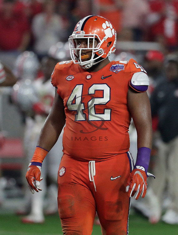 Clemson defensive lineman Christian Wilkins (42) during the Fiesta Bowl NCAA college football game against Ohio State, Saturday, Dec. 31, 2016, in Glendale, Ariz. (AP Photo/Rick Scuteri)