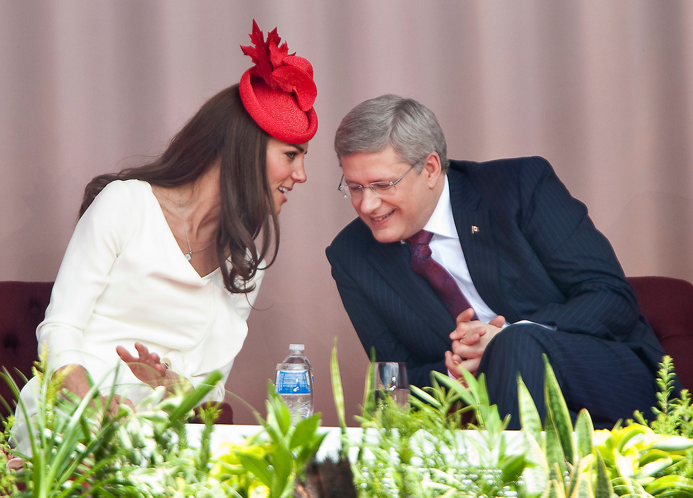 Catherine the Duchess of Cambridge speaks with Canadian Prime Minister Stephen Harper during Canada Day celebrations on Parliament Hill in Ottawa, Canada, July 1, 2011. The Duke and Duchess are on a nine day tour of Canada, their first official foreign trip as husband and wife.<br /> AFP PHOTO/GEOFF ROBINS