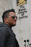 Picture by Mark Larner / Retna Pictures. Picture shows Peter Andre outside the High Court, London. November 10th, 2009. Andre was in court today to accept an apology from IPC Media over false allegations made in Now Magazine over accidents involving Miss Price's child Harvey. Seperately Mr. Andre was also said to have demanded sick sexual threesomes from his wife. IPC Media has accepted that the allegations were totally untrue.