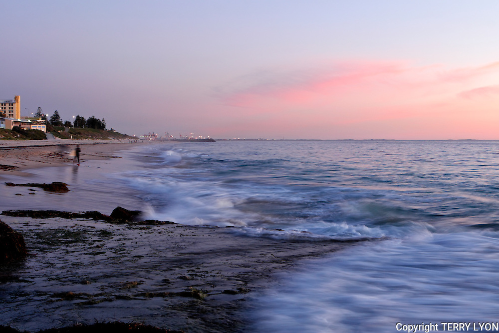 Sunset over the rocks at Grant street North Cottesloe a popular fishing spot.