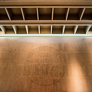 A large presidential seal is etched in the wall of a large internal atrium at the LBJ Library. The LBJ Library and Museum (LBJ Presidnetial Library) is one of the 13 presidential libraries administered by the National Archives and Records Administration. It houses historical documents from Lyndon Johnson's presidency and political life as well as a museum.