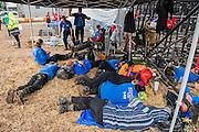Security guard take a rest next to the Pyramid Stage - The 2016 Glastonbury Festival, Worthy Farm, Glastonbury.