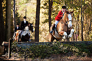 A fox hunter clears a wall during the Middleton Place foxhunt at Middleton Place plantation in Charleston, South Carolina. The hunt is a drag hunt where a scented cloth is used instead of live fox.