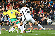 Picture by Paul Chesterton/Focus Images Ltd.  07904 640267.31/03/12.Aaron Wilbraham of Norwich scores his sides only goal and celebrates during the Barclays Premier League match at Craven Cottage stadium, London.